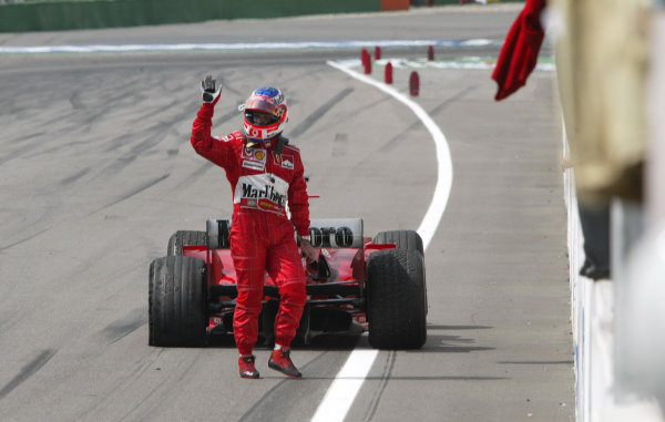 2004 German Grand Prix - Sunday Race,Hockenheim, Germany. 25th July 2004 Rubens Barrichello, Ferrari F2004, barely manages to finish the race as a puncture causes him to park his car on the finish line.World Copyright: Steve Etherington/LAT Photographic ref: Digital Image Only