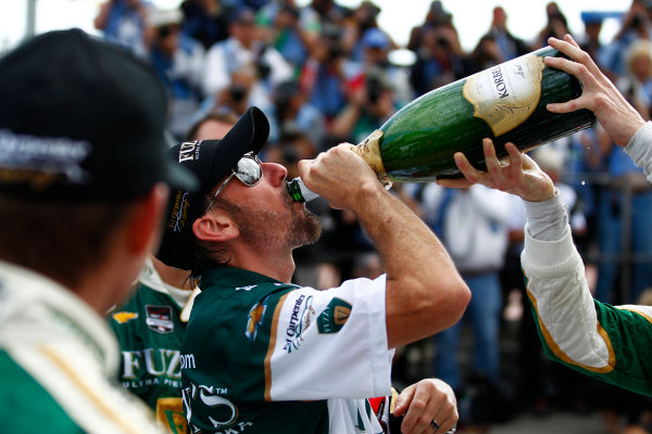 11-13 April, 2014, Long Beach, California USA Lee Bentham gets a little help with the champagne bottle from Mike Conway  ©2014, Phillip Abbott LAT Photo USA