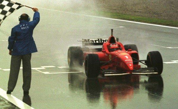 1996 Spanish Grand Prix.Catalunya, Barcelona, Spain.31/5-2/6 1996.Michael Schumacher (Ferrari F310) 1st position takes the chequered flag.World Copyright - LAT Photographic