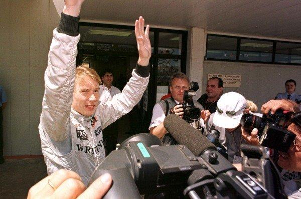 1998 Spanish Grand Prix.Catalunya, Barcelona, Spain.8-10 May 1998.Mika Hakkinen (McLaren Mercedes-Benz) after qualifying on pole position.World Copyright - LAT Photographic