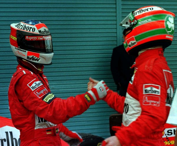 1997 Japanese Grand Prix.Suzuka, Japan.10-12 October 1997.Michael Schumacher and Eddie Irvine (both Ferrari) after they finished in 1st and 3rd positions respectively.World Copyright - LAT Photographic