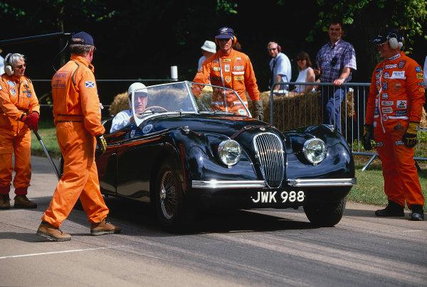 2002 Goodwood Festival of SpeedGoodwood, England. 12th - 14th July 2002.Sir Stirling Moss, Jaguar XK120 Alloy Roadster.World Copyright: Jeff Bloxham/LAT Photographicref: 35mm Image A12