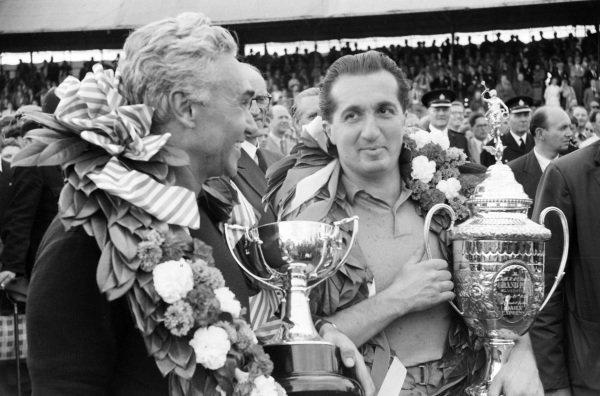 Alberto Ascari and team mate Piero Taruffi celebrate first and second place.