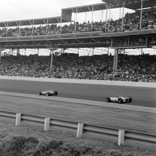 Jim Clark, Lotus 38 Ford, leads Rodger Ward, John Mecom, Lola T90 Offenhauser.