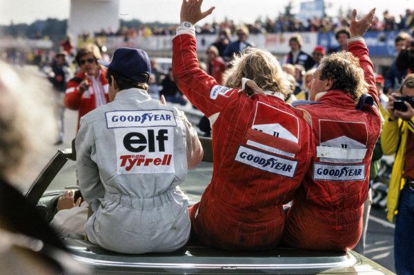 Jody Scheckter, James Hunt and Jochen Mass on the victory lap.