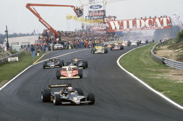Pole sitter Mario Andretti, Lotus 79 Ford leads Gilles Villeneuve, Ferrari 312T3, Jody Scheckter, Wolf WR5 Ford and team mate Ronnie Peterson, Lotus 78 Ford at the start.