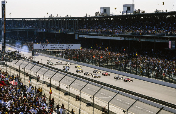 Michael Schumacher, Ferrari F2001, leads the field at the start.