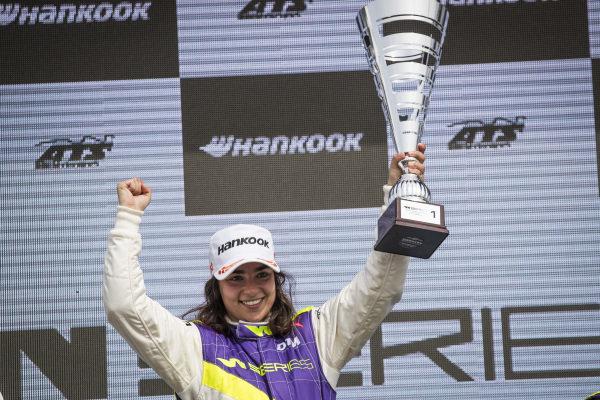 Jamie Chadwick (GBR), celebrates on the podium after winning the race
