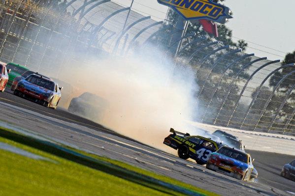 14 February, 2010, Daytona Beach, Florida USA USAA J. Allmendinger (#43) spins after hitting the wall exiting turn 2, narrowly missing Kyle Busch (#18).©F. Peirce Williams 2010 USALAT Photographic