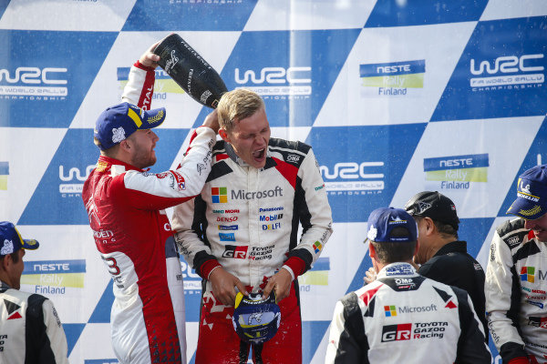 Ott Tanak and second placed driver Mads Ostberg on the Rally Finland podium
