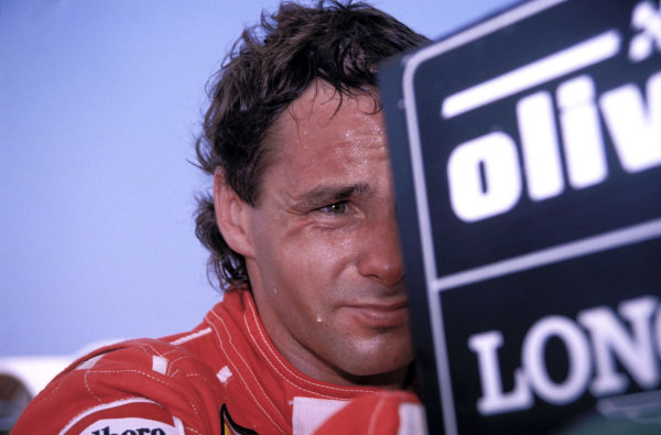 Gerhard Berger watches a timing screen in the pits.