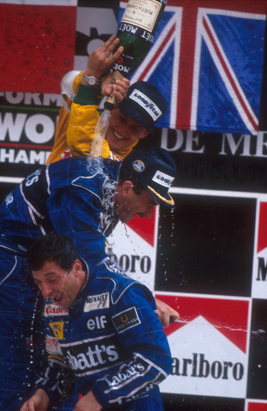 1992 Mexican Grand Prix.Mexico City, Mexico.20-22 March 1992.Nigel Mansell, 1st position and Riccardo Patrese 2nd position (both Williams Renault) get showered with champagne from Michael Schumacher (Benetton Ford) 3rd position on the podium.Ref-92 MEX 05.World Copyright - LAT Photographic
