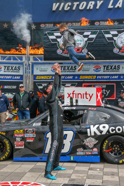 #18: Kyle Busch, Joe Gibbs Racing, Toyota Supra iK9 victory lane, Brexton