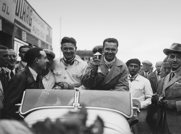 Nurburgring, Germany. 19th July 1931. Rudolf Caracciola (Mercedes-Benz SSKL) and his mechanic,Wilhelm Sebastian, celebrate 1st position in the pits, portrait.  World Copyright: LAT Photographic. Ref:  Autocar Glass Plate B6838