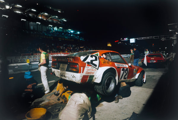 Le Mans, France. 14 - 15 June 1975 Andre Haller/Hans Schuller/Benoit Maechler (Datsun 240Z), 26th position overall, pit stop at night, action.  World Copyright: LAT Photographic. Ref:  75LM