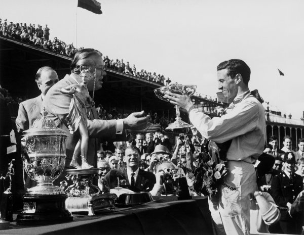 Aintree, Great Britain. 19th - 21st July 1962.Jim Clark (Lotus 25-Climax), 1st position, with the winners trophy, podium. portrait. World Copyright: LAT Photographic.Ref:  B/W Print.