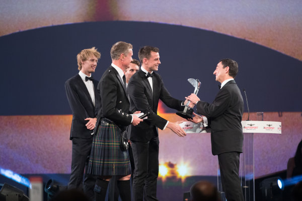 2017 Autosport Awards Grosvenor House Hotel, Park Lane, London. Sunday 3 December 2017. WEC Champions Brendon Hartley, Timo Bernhard and Earl Bamber present the John Bolster award to Pierre Fillon on behalf of the Automobile Club de l'Ouest. World Copyright: Zak Mauger/LAT Images  ref: Digital Image _O3I7328