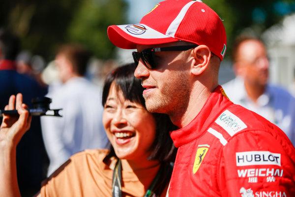 Sebastian Vettel, Ferrari, has his photo taken with a fan.