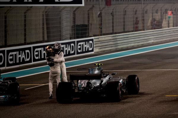 Yas Marina Circuit, Abu Dhabi, United Arab Emirates. Sunday 26 November 2017. Valtteri Bottas, Mercedes AMG, 1st Position, and Lewis Hamilton, Mercedes AMG, 2nd Position, celebrate. World Copyright: Glenn Dunbar/LAT Images  ref: Digital Image _31I9262