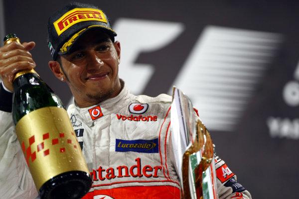 Yas Marina Circuit, Abu Dhabi, United Arab Emirates 13th November 2011. Lewis Hamilton, McLaren MP4-26 Mercedes, 1st position. Portrait. Podium.  World Copyright: Andy Hone/LAT Photographic  ref: Digital Image CSP23076
