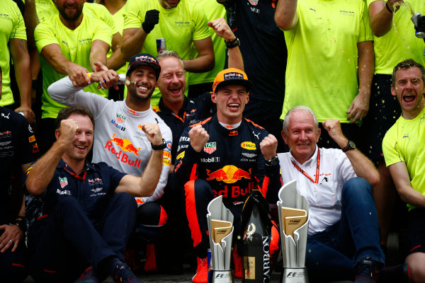 Sepang International Circuit, Sepang, Malaysia. Sunday 1 October 2017. Max Verstappen, Red Bull, 1st Position, Daniel Ricciardo, Red Bull Racing, 3rd Position, Christian Horner, Team Principal, Red Bull Racing, Helmut Markko, Consultant, Red Bull Racing, and the Red Bull team celebrate. World Copyright: Andrew Hone/LAT Images  ref: Digital Image _ONZ0527