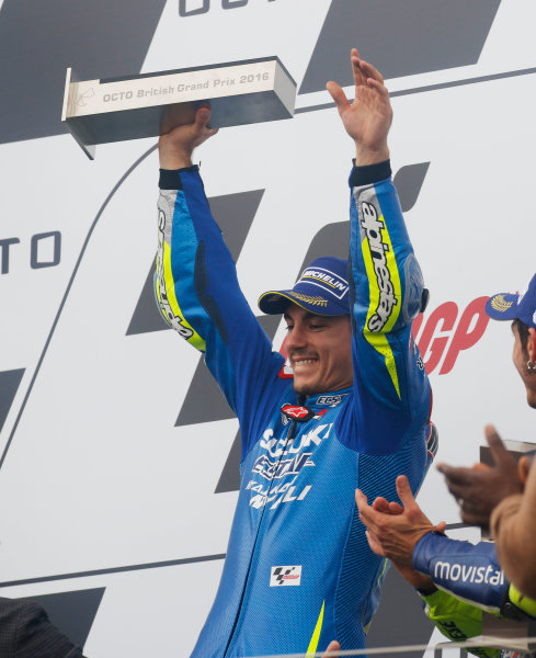 2016 MotoGP Championship.  British Grand Prix.  Silverstone, England. 2nd - 4th September 2016.  Maverick Vinales, Suzuki, celebrates on the podium.  Ref: _W7_9495a. World copyright: Kevin Wood/LAT Photographic