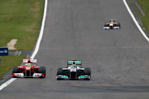 Nurburgring, Germany24th July 2011Nico Rosberg, Mercedes GP W02, 7th position, leads Felipe Massa, Ferrari 150° Italia, 5th position. Action.  World Copyright:Glenn Dunbar/LAT Photographicref: Digital Image C27C4580
