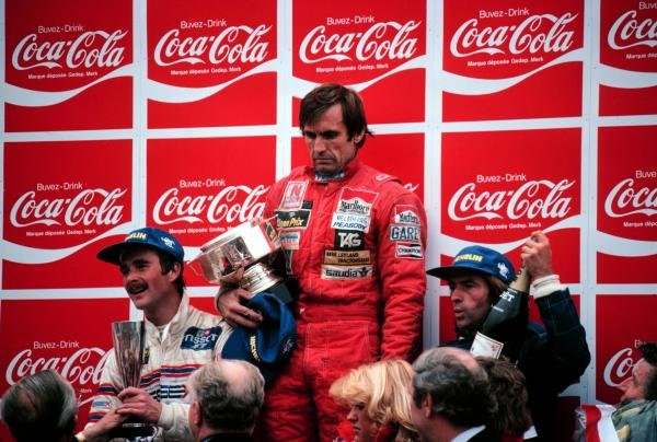 There was little to celebrate for race winner Carlos Reutemann (ARG) Williams (centre) following his accidental involvement in the fatal accident of Osella mechanic Giovanni Amedeo on the Friday. Jacques Laffite (FRA) Ligier (Right) was second and Nigel Mansell (GBR) (Lotus) (left) took his first podium finish with third. Belgian Grand Prix, Zolder, 17 May 1981.