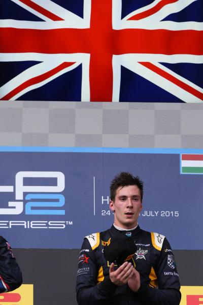 Race one winner Alex Lynn (GBR) DAMS celebrates on the podium at GP2 Series, Rd6, Hungaroring, Hungary, 24-26 July 2015.