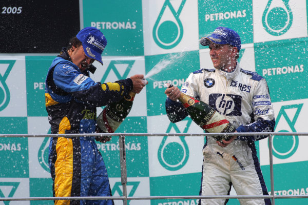 2005 Malaysian Grand Prix - Sunday Race, Sepang, Kuala Lumpur. Malaysia. 20th March 2005 Race podium - winner Fernando Alonso, Renault R25 (1st) and Nick Heidfeld, Williams F1 BMW FW27 (3rd), spray the soft drink champagne substitute.World Copyright: Steve Etherington/LAT Photographic ref: 48mb Hi Res Digital Image Only