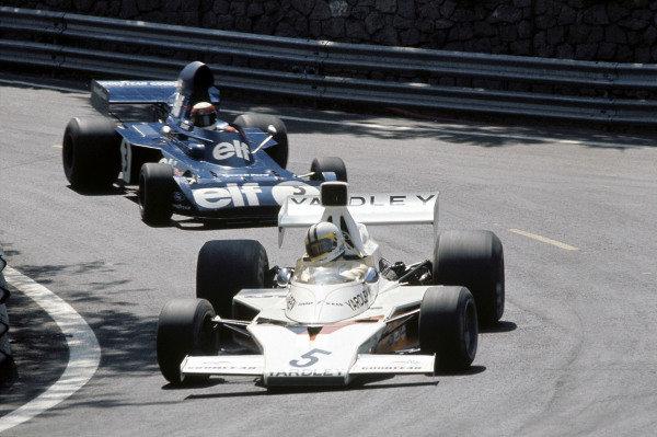 1973 Spanish Grand Prix.Montjuich Park, Barcelona, Spain. 29 April 1973.Denny Hulme (McLaren M23-Ford) leads Jackie Stewart (Tyrrell-Ford).World Copyright: LAT Photographicref: 35mm Transparency Image