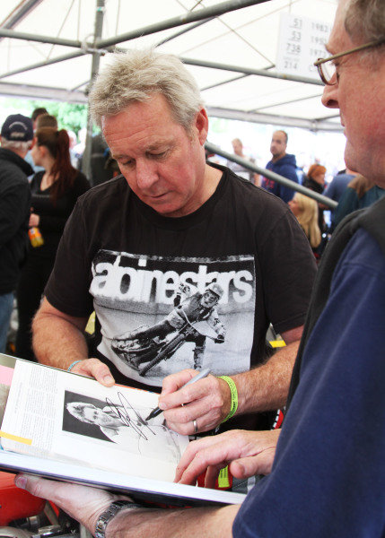 Goodwood Estate, West Sussex, England. 28th June - 1st July 2012. Wayne Gardner signs an autograph. World Copyright: Kevin Wood/LAT Photographic Ref: IMG_9362a