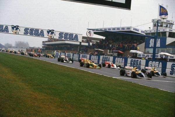 1993 European Grand Prix. Donington Park, England. 9-11 April 1993. Alain Prost and teammate Damon Hill (both Williams FW15C Renault's) on the front row of the grid for the start, followed by Michael Schumacher (Benetton B193B Ford), Ayrton Senna (McLaren MP4/8 Ford), Karl Wendlinger (Sauber C12 Ilmor), Michael Andretti (McLaren MP4/8 Ford), Gerhard Berger (Ferrari F93A), Jean Alesi (Ferrari F93A) and Riccardo Patrese (Benetton B193B Ford). World Copyright: LAT Photographic. Ref:  93 EUR 16.