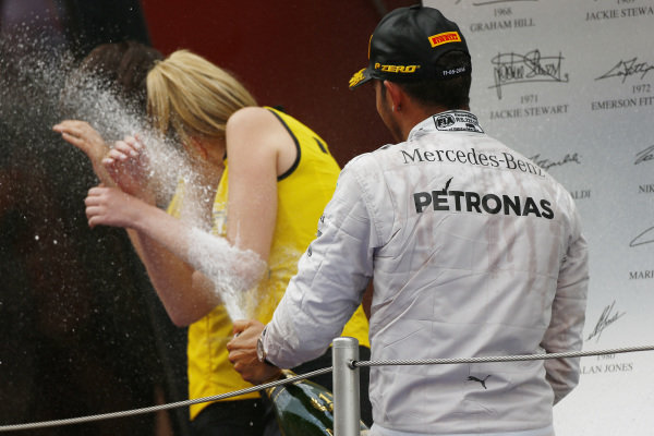 Circuit de Catalunya, Barcelona, Spain. Sunday 11 May 2014. Lewis Hamilton, Mercedes AMG, 1st Position, sprays some grid girls. World Copyright: Andy Hone/LAT Photographic. ref: Digital Image _ONY2239