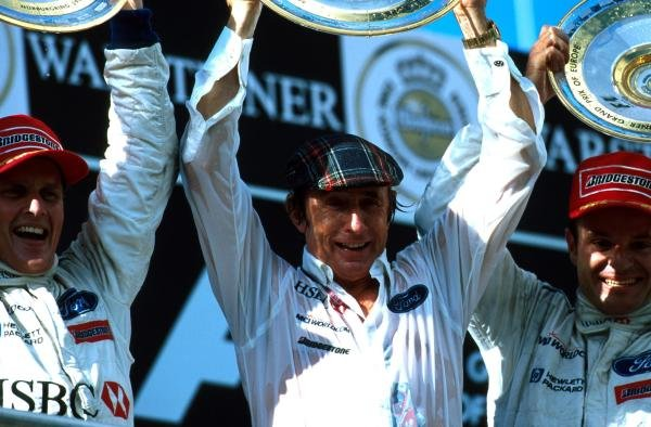 L to R Winner Johnny Herbert, Team Boss Jackie Stewart and third placed Rubens Barrichello European Grand Prix, Rd 14, Nurburgring, Germany, 26 September 1999.