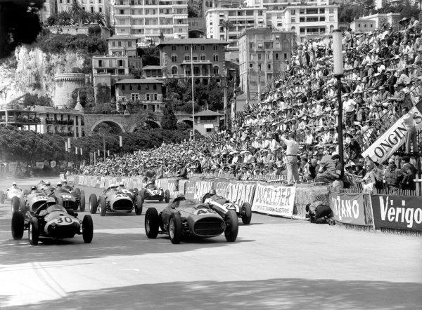 1959 Monaco Grand Prix.Monte Carlo, Monaco. 10 May 1959.Stirling Moss, #30 Cooper T51-Climax, retired, and Jean Behra, #46 Ferrari Dino 246, retired, lead Tony Brooks, #50 Ferrari Dino 246, 2nd position, Jo Bonnier, #18 BRM P25, retired, Phil Hill, #48 Ferrari Dino 246, 4th position, and Jack Brabham, #24 Cooper T51-Climax, 1st position, at the start. The action is captured by a near-suicidal cameraman.World Copyright: LAT PhotographicRef: C55006