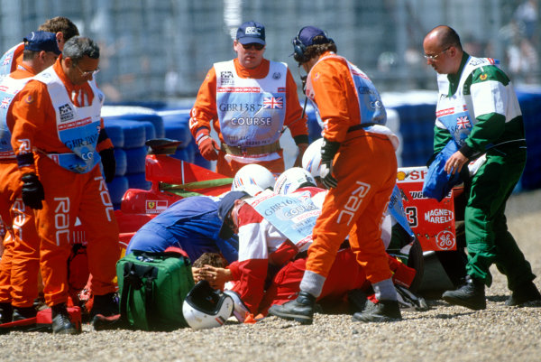 1999 British Grand Prix. Silverstone, England. 9th - 11th July 1999. Michael Schumacher (Ferrari F399), crashes heavily into the tyre barriers at Stowe on the first lap, breaking his leg. World Copyright: LAT Photographic.  Ref:  99_GB_MS_Crash_03.