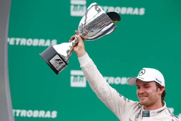 Interlagos, Sao Paulo, Brazil. Sunday 15 November 2015. Nico Rosberg, Mercedes AMG, 1st Position, lifts his trophy on the podium. World Copyright: Glenn Dunbar/LAT Photographic ref: Digital Image _89P7217