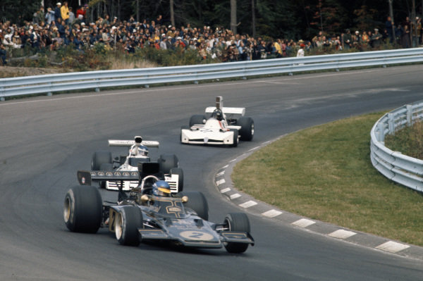 Ronnie Peterson, Lotus 72E Ford leads Carlos Reutemann, Brabham BT42 Ford and James Hunt, March 731 Ford.