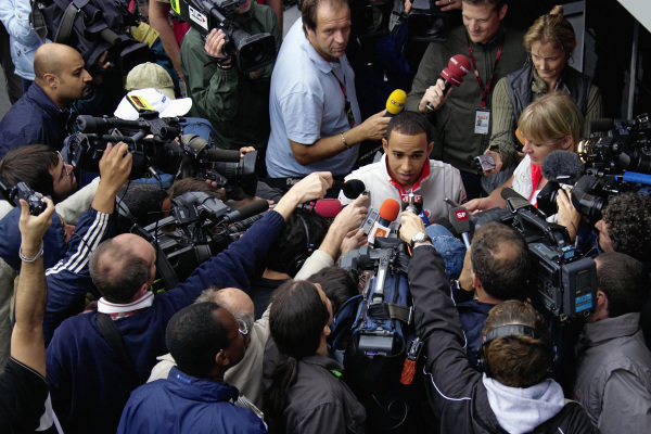 Lewis Hamilton highly in demand for an interview in the paddock.