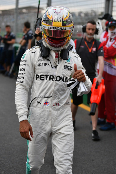 Pole sitter Lewis Hamilton (GBR) Mercedes AMG F1 celebrates in parc ferme at Formula One World Championship, Rd1, Australian Grand Prix, Qualifying, Albert Park, Melbourne, Australia, Saturday 25 March 2017.