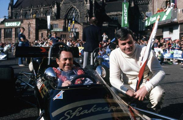 (L to R): Jack Brabham (AUS) and Alan Jones (AUS). Lucas On The Streets Sports Spectacular, Birmingham, England, 12 October 1980.