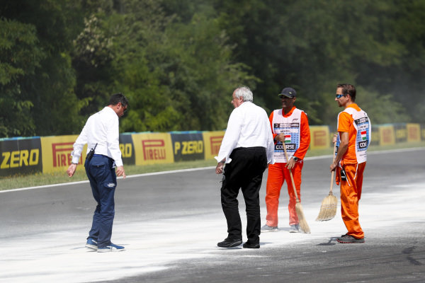 Michael Masi, Race Director inspects Marshals cleaning up oil spill from the F2 race