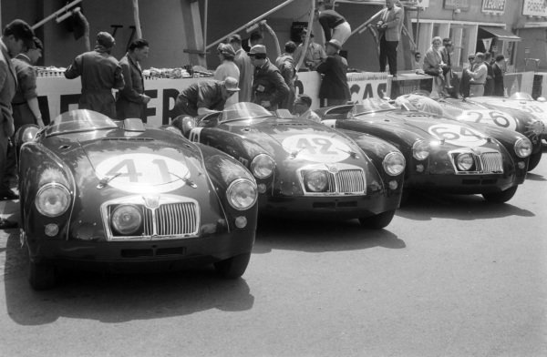 Ken Miles / Johnny Lockett's (#41), Dick Jacobs / Joe Flynn's (#42), and Ted Lund / Hans Waeffler's (#64) MG Cars, MG EX 182s in the pits.