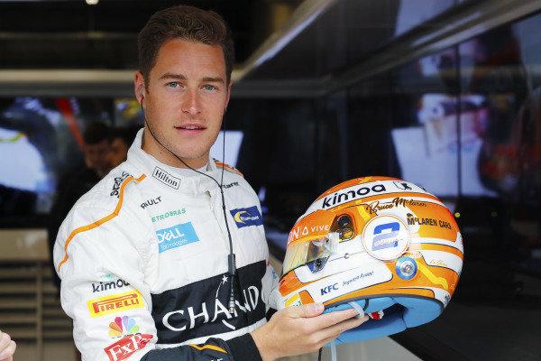 Stoffel Vandoorne, McLaren, shows off a new helmet design, with Bruce McLaren's name on it.