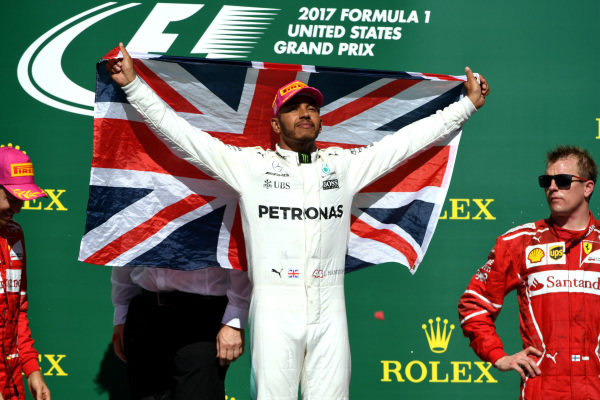 Race winner Lewis Hamilton (GBR) Mercedes AMG F1 celebrates on the podium with the Union Jack flag at Formula One World Championship, Rd17, United States Grand Prix, Race, Circuit of the Americas, Austin, Texas, USA, Sunday 22 October 2017.