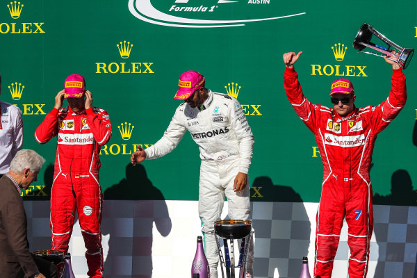 Kimi Raikkonen (FIN) Ferrari celebrates on the podium with Bill Clinton (USA), Sebastian Vettel (GER) Ferrari, race winner Lewis Hamilton (GBR) Mercedes AMG F1 and the trophy at Formula One World Championship, Rd17, United States Grand Prix, Race, Circuit of the Americas, Austin, Texas, USA, Sunday 22 October 2017.