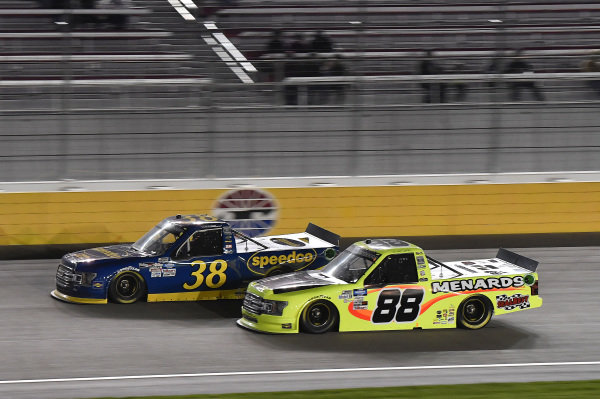 #38: Todd Gilliland, Front Row Motorsports, Ford F-150 Black's Tire, #88: Matt Crafton, ThorSport Racing, Ford F-150 Damp Rid / Menards