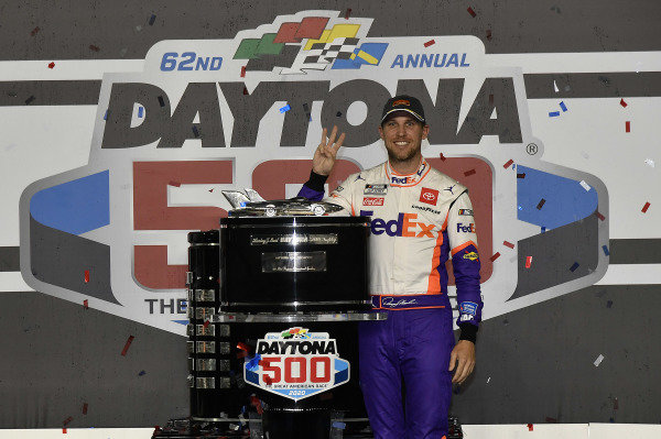#11: Denny Hamlin, Joe Gibbs Racing, Toyota Camry FedEx Express, celebrates in victory Lane after winning the Daytona 500.