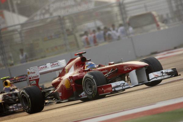 Fernando Alonso, Ferrari 150° Italia, leads Mark Webber, Red Bull RB7 Renault.